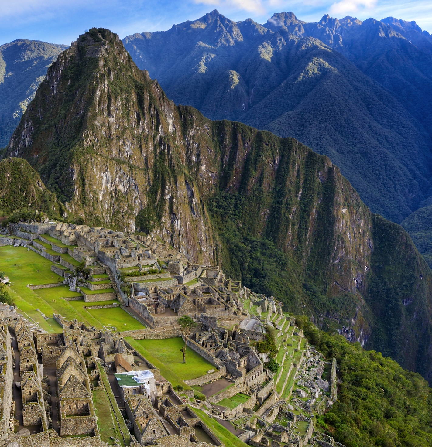 Aerial view of Machu Picchu and surrounding mountain peaks