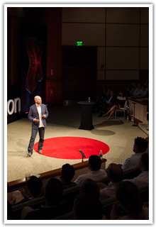Speaker on stage during a TEDx talk - shot from high above state