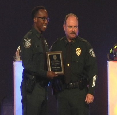 USF police Officer Richard Curry receives plaque with USF police Chief J.D. Withrow