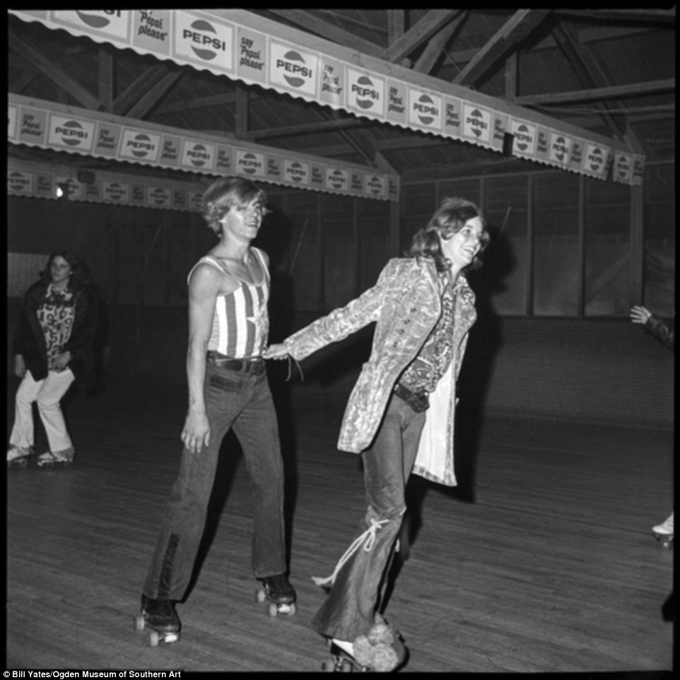 black and white photo of 1972 girl and boy at roller rink