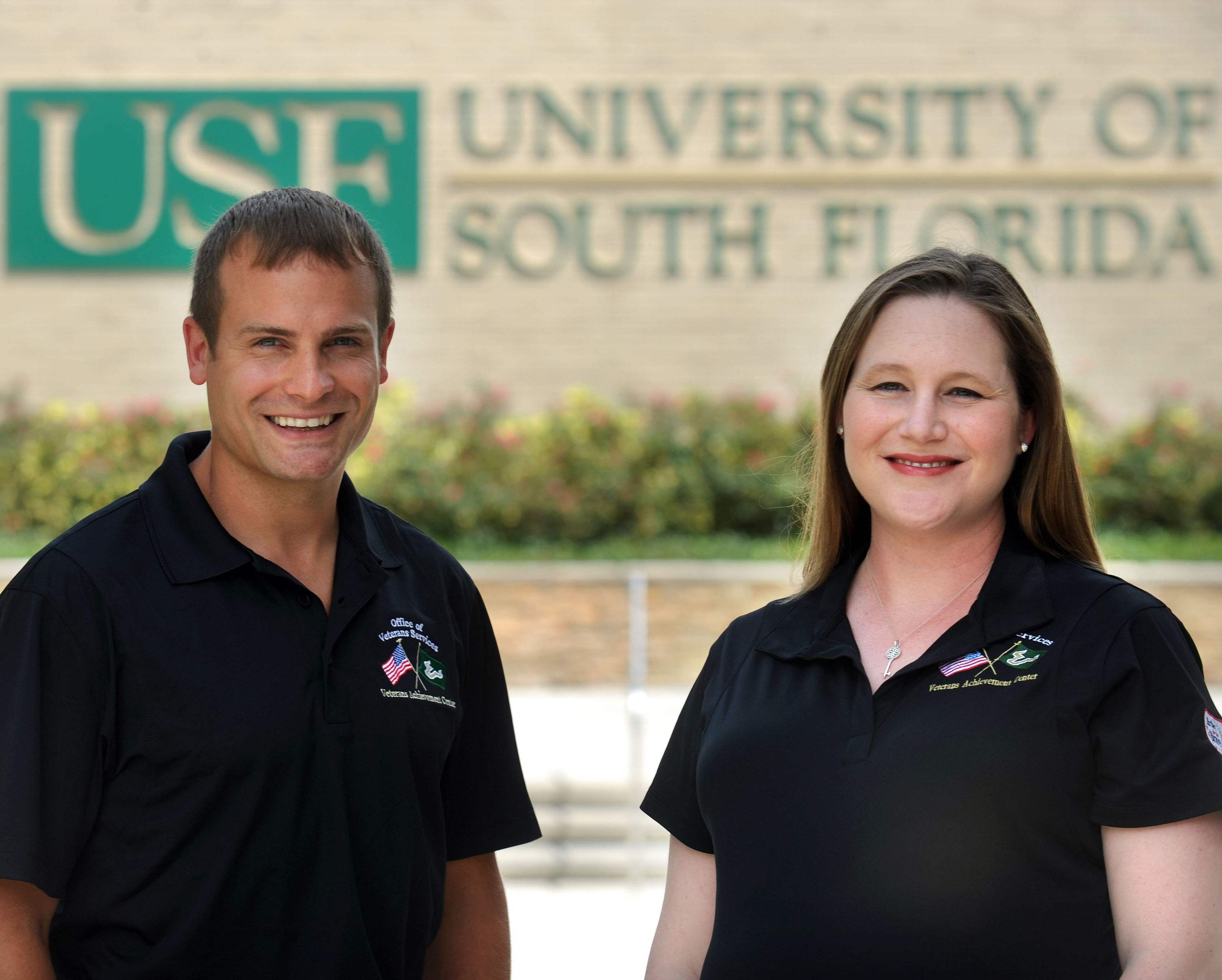Mary Lynn Conroy and John Pasciak portraits with USF sign in background